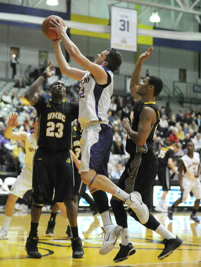 UAlbany's Peter Hooley goes to the basket during their men's college basketball game against UMBC at the SEFCU Arena on Wednesday Jan. 8, 2014 in Albany, N.Y. (Michael P. Farrell/Times Union) Photo: Michael P. Farrell / 00024945A