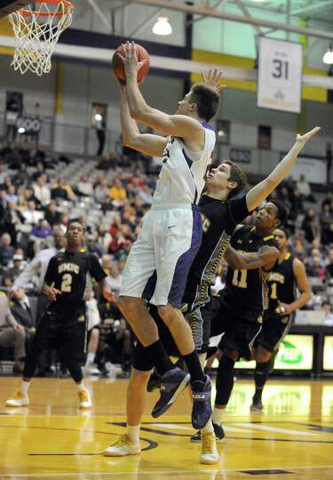 UAlbany's Dave Wiegmann goes to the basket during their men's college basketball game against UMBC a
