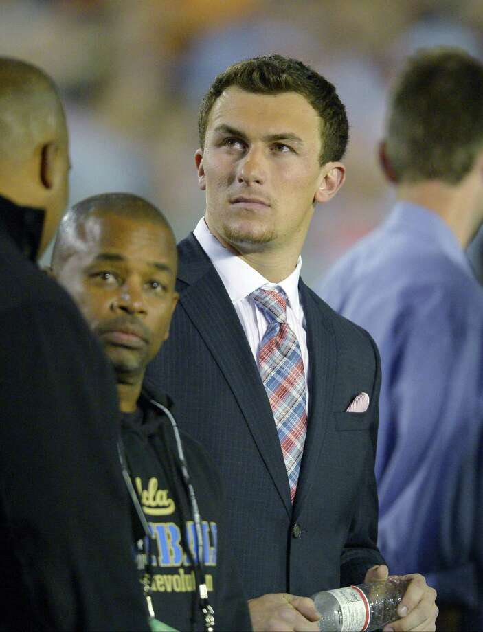 Quarterback Johnny Manziel has looked and acted more like a professional football player compared to his early days in the spotlight. Photo: Mark J. Terrill / Associated Press / AP