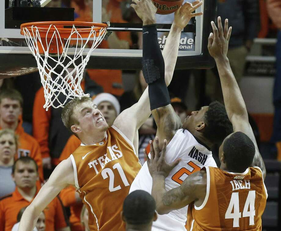 Texas' Connor Lammert (left) blocks a shot by Oklahoma State's Le'Bryan Nash during the first half in Stillwater. Lammert scored 11 points in the Longhorns' loss. Photo: Sue Ogrocki / Associated Press / AP