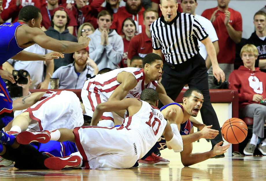 Kansas' Perry Ellis, right, tries to emerge from a tangle of Oklahoma players with a loose ball. Photo: Alonzo Adams, FRE / FR159426 AP