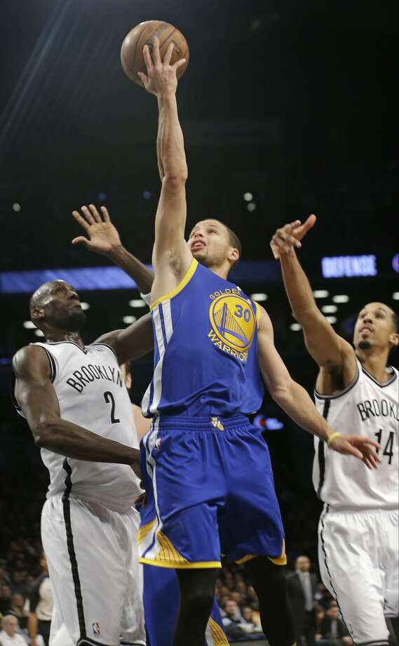 Stephen Curry rises above Brooklyn's Kevin Garnett and Shaun Livingston. Photo: Frank Franklin II, Associated Press