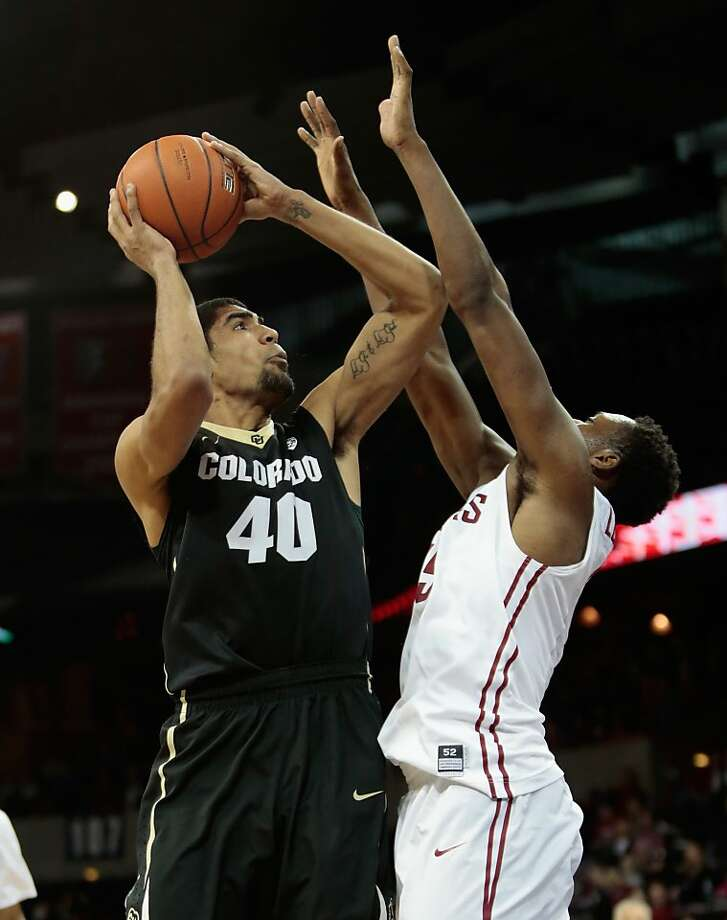 Colorado's Josh Scott tries to score over the Cougars' Junior Longrus. Scott had 19 points. Photo: William Mancebo, Getty Images