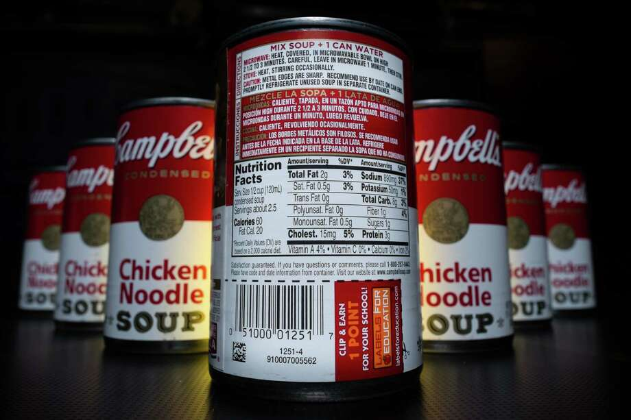 The nutrition information is shown on the back of a Campbell's Chicken Noodle soup can in Washington, Wednesday, Jan. 8, 2014. Some of the nation's largest food companies have cut their calories by the trillions according to a new study. Photo: J. David Ake, AP / AP