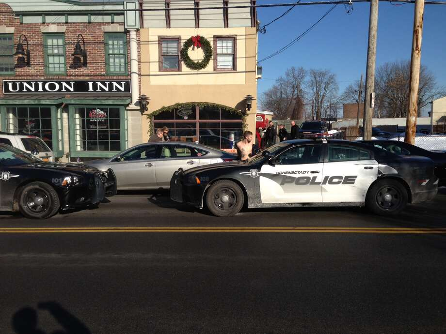 Police removed two men from the Union Inn, 517 Union St., Schenectady. (Paul Nelson/Times Union)