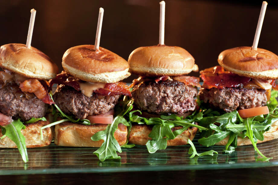 "OUT: Mini-burgers, or sliders. Half of chefs surveyed said these cute little things are not hot. (By the way, the survey asked chefs to rate 209 food items as ""hot trend,"" ""yesterday's news,"" or ""perennial favorite."")  Photo: Juanmonino, Getty Images / (c) Juanmonino"