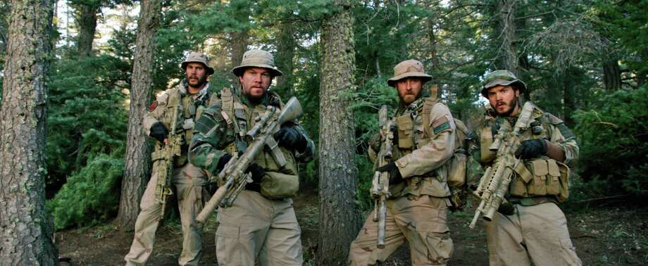 "This photo released by Universal Pictures shows, from left, Taylor Kitsch, as Michael Murphy, Mark Wahlberg as Marcus Luttrell, Ben Foster as Matt ""Axe"" Axelson, and Emile Hirsch as Danny Dietz in a scene from the film, ""Lone Survivor."" In the age of the superhero, the movies' most reliable real-life hero has been the Navy SEAL. ""Lone Survivor,"" is the latest in a string of films, including ""Zero Dark Thirty"" and ""Act of Valor"" to honor the Navy's special operations force with as much faithfulness as the filmmakers could muster. (AP Photo/Universal Pictures) ORG XMIT: NYET215 / Universal Pictures"