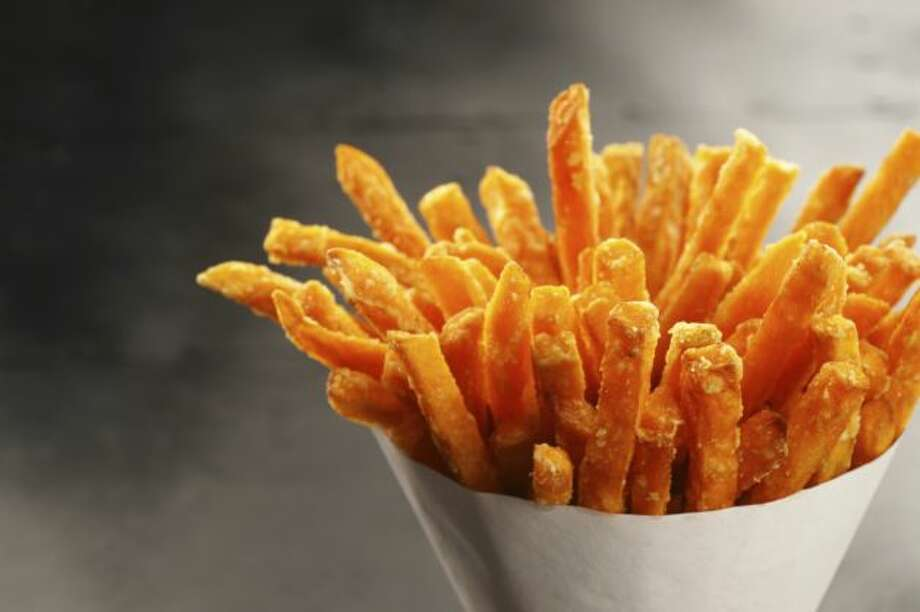 """OUT: Sweet potato fries. They're still on every burger menu,  where they somehow feel healthier than regular fries. But 49 percent of  chefs say they're """"yesterday's news."""" Photo: Courtesy"""