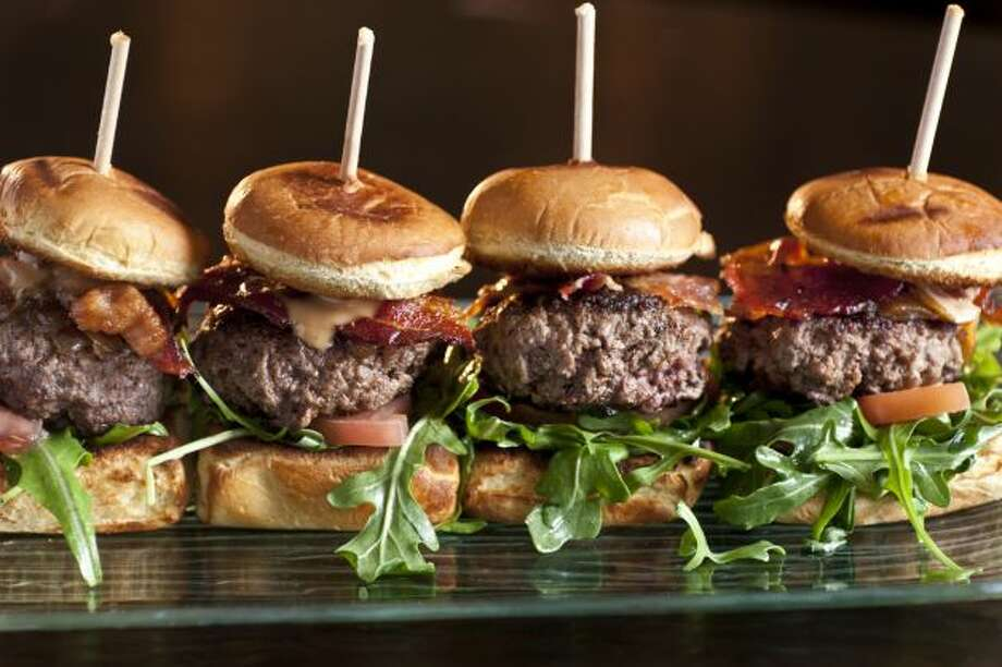 """OUT: Mini-burgers, or sliders. Half of chefs surveyed said these  cute little things are not hot. (By the way, the survey asked chefs to  rate 209 food items as """"hot trend,"""" """"yesterday's news,"""" or """"perennial  favorite."""") Photo: Courtesy"""