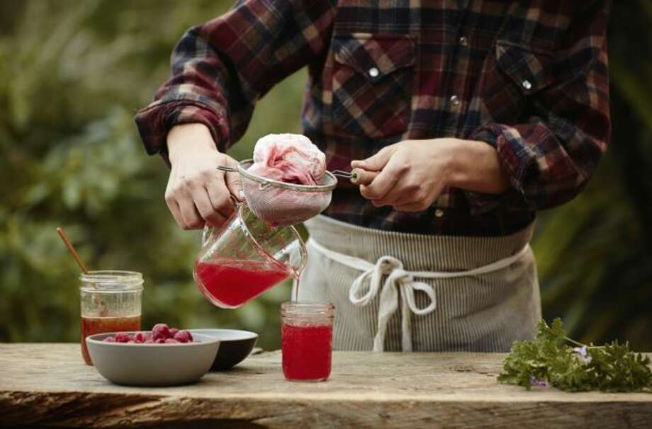 IN: House-made sodas and soft drinks. Think gourmet lemonade, rhubarb pop and freshly muddled mint. Pictured is a guy making fermented strawberry soda. Photo: Courtesy