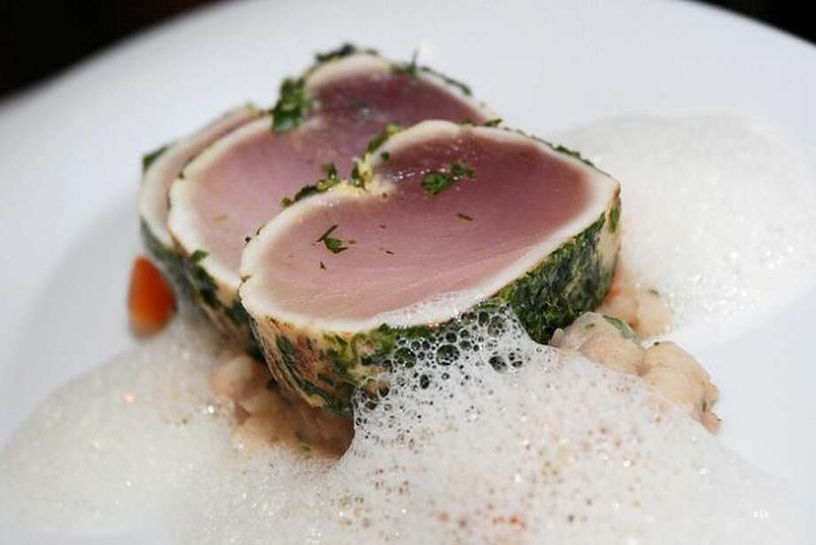 OUT: Foam and froth. Foamy accents on fancy plates are over, says the foodie forecast. Pictured is albacore with bacon froth.  Photo: Courtesy