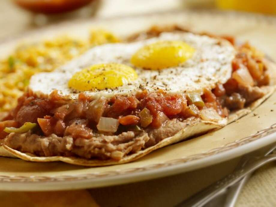 IN: Ethnic breakfasts, like huevos rancheros, pictured, and 