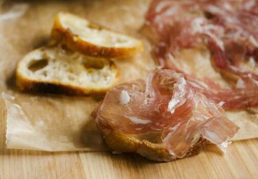 "Charcuterie (shar-koot-a-REE): Prepared meats, particularly pork, such as terrines, pâtés and cured products. Audio: Click here to hear the term ""Charcuterie."" Photo: Courtesy"