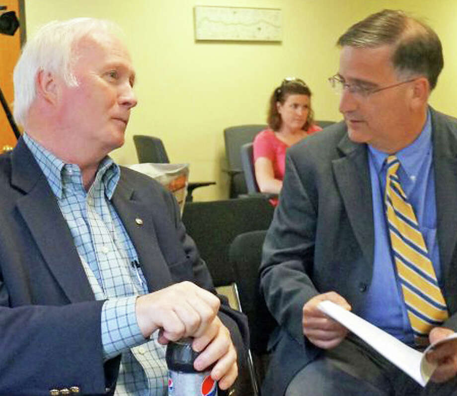 Board of Education Chairman Philip Dwyer, left and Superintendent of Schools David Title, in this file photo from last year, have imposed on a budget freeze as mounting costs for special-needs student outplacements threaten to create a deficit in the schools' 2013-14 budget. Photo: File Photo / Fairfield Citizen