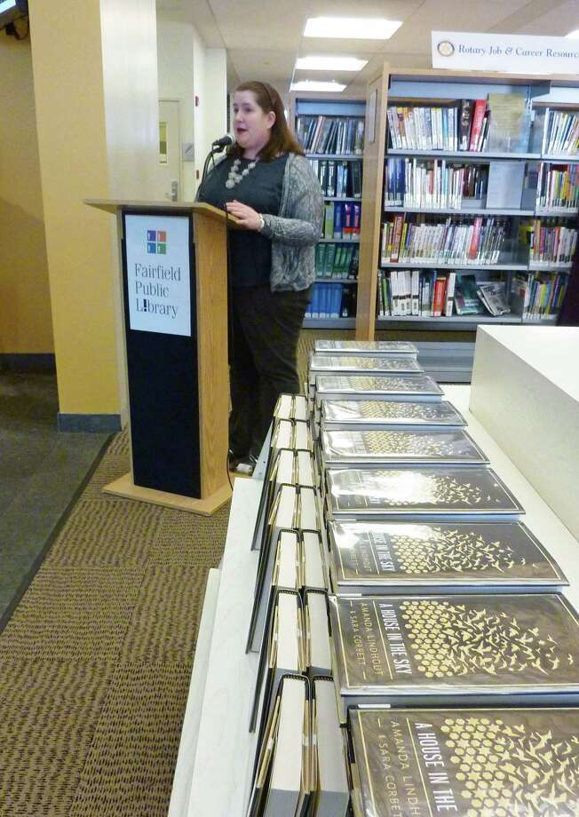 "Teen Librarian Nicole Scherer discusses the One Book One Town selection for 2014, ""The House in the Sky."" Photo: Genevieve Reilly / Fairfield Citizen"