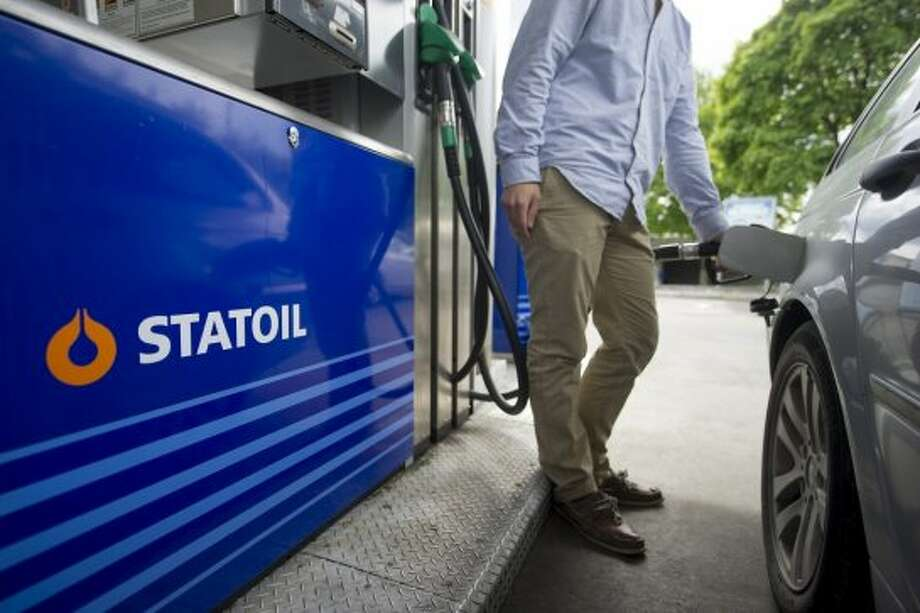 A customer refuels his vehicle with diesel fuel on the forecourt of a gas station operated by Statoil ASA in Oslo, Norway.