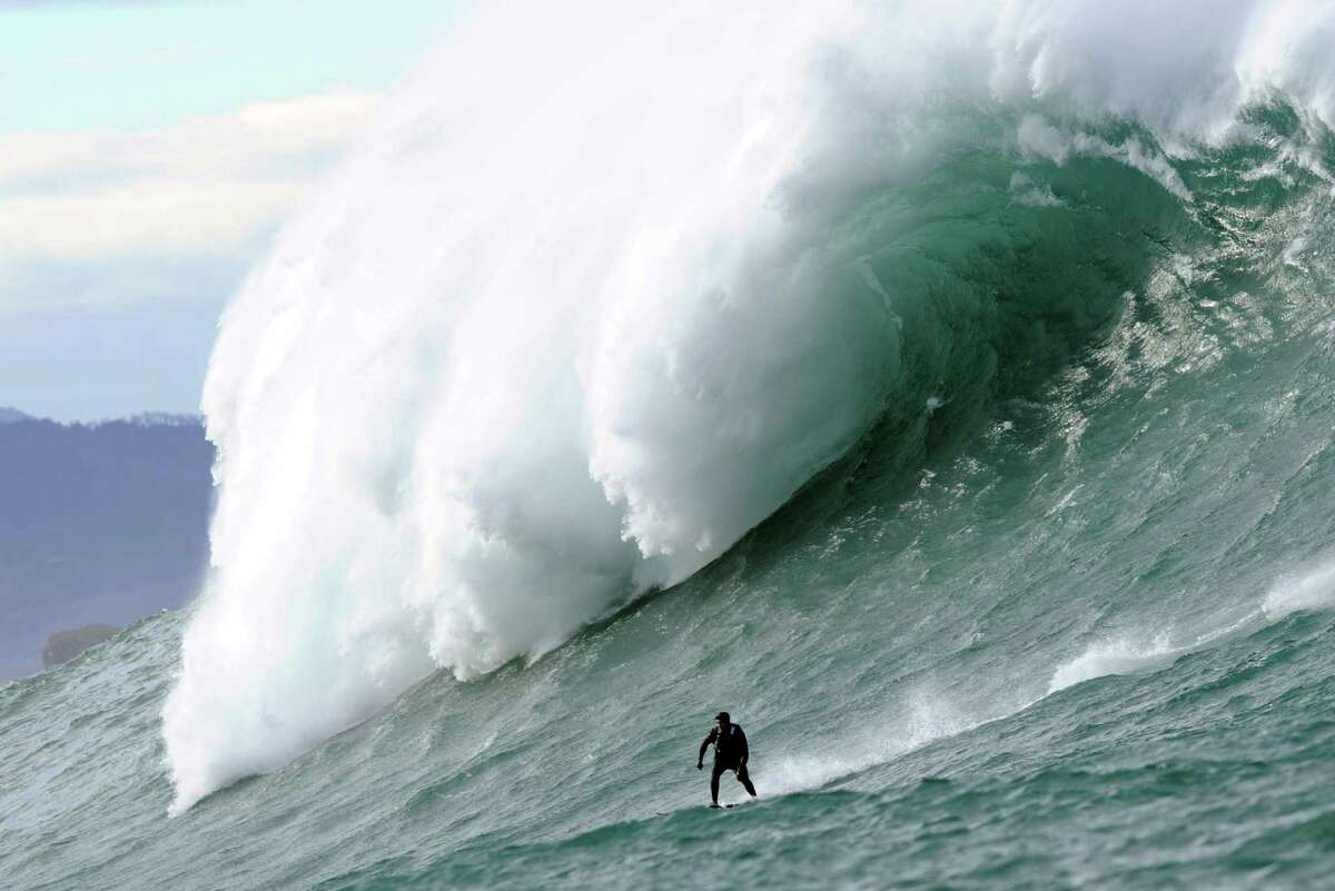 A man surfs the Belharra giant waves some 2 kilometers off the coast of the French basque country town of Urrugne on Tuesday, Jan. 7, 2014. Thanks to certain climatic conditions in autumn and winter, a strong swell hits the Belharra Perdun underwater spur enabling a 10- to 15-meter wave to form.