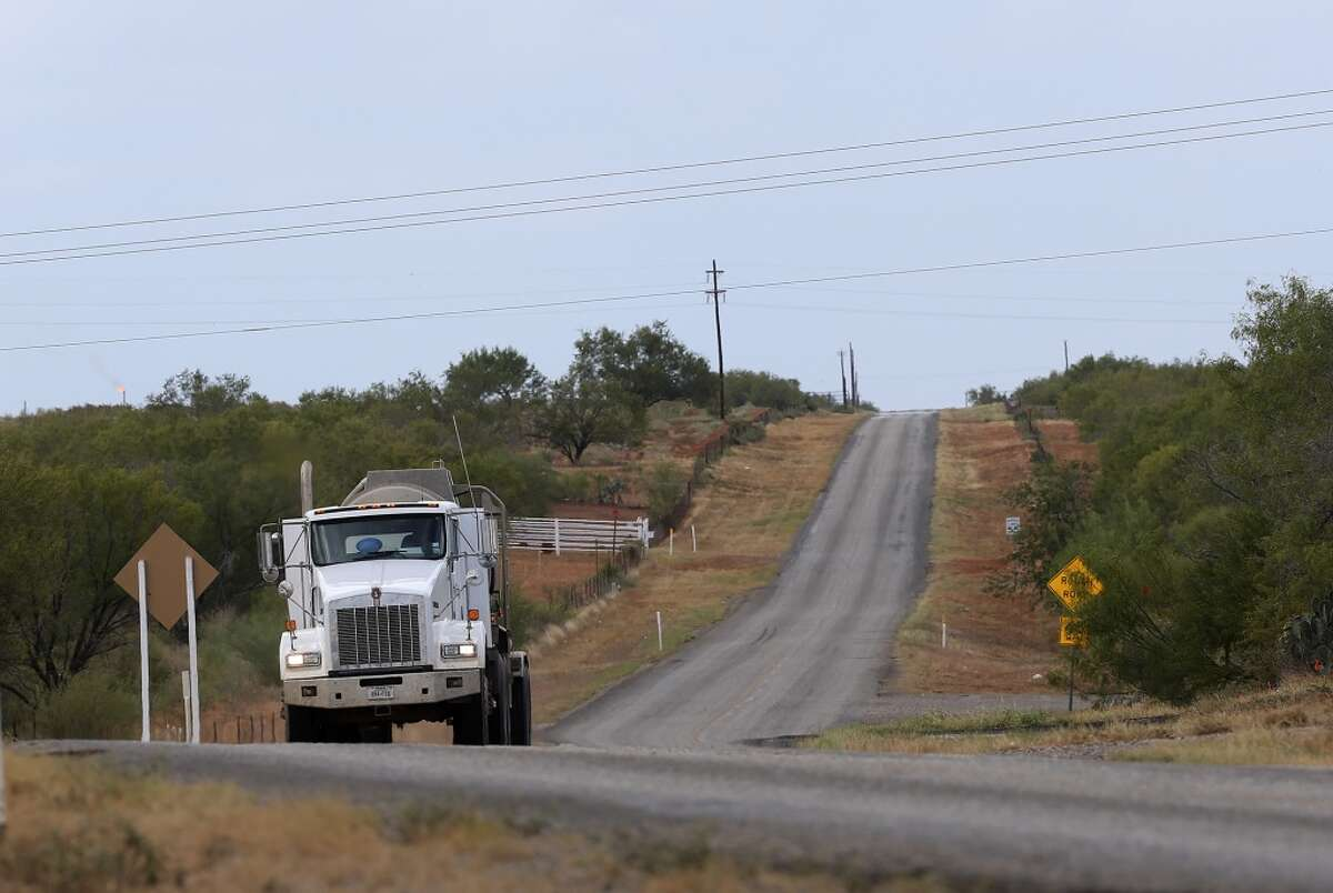 Oil-field related traffic moves on FM 469 in La Salle County, north west of Cotulla on Sept. 10, 2013.