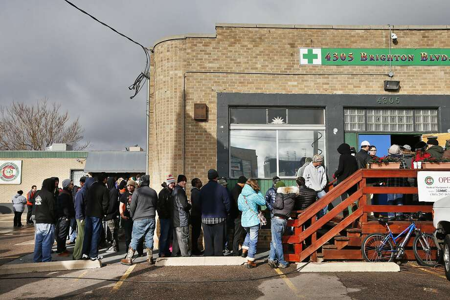 Customers stand in line at the 3D Cannabis Center in Denver. Photo: Brennan Linsley, Associated Press