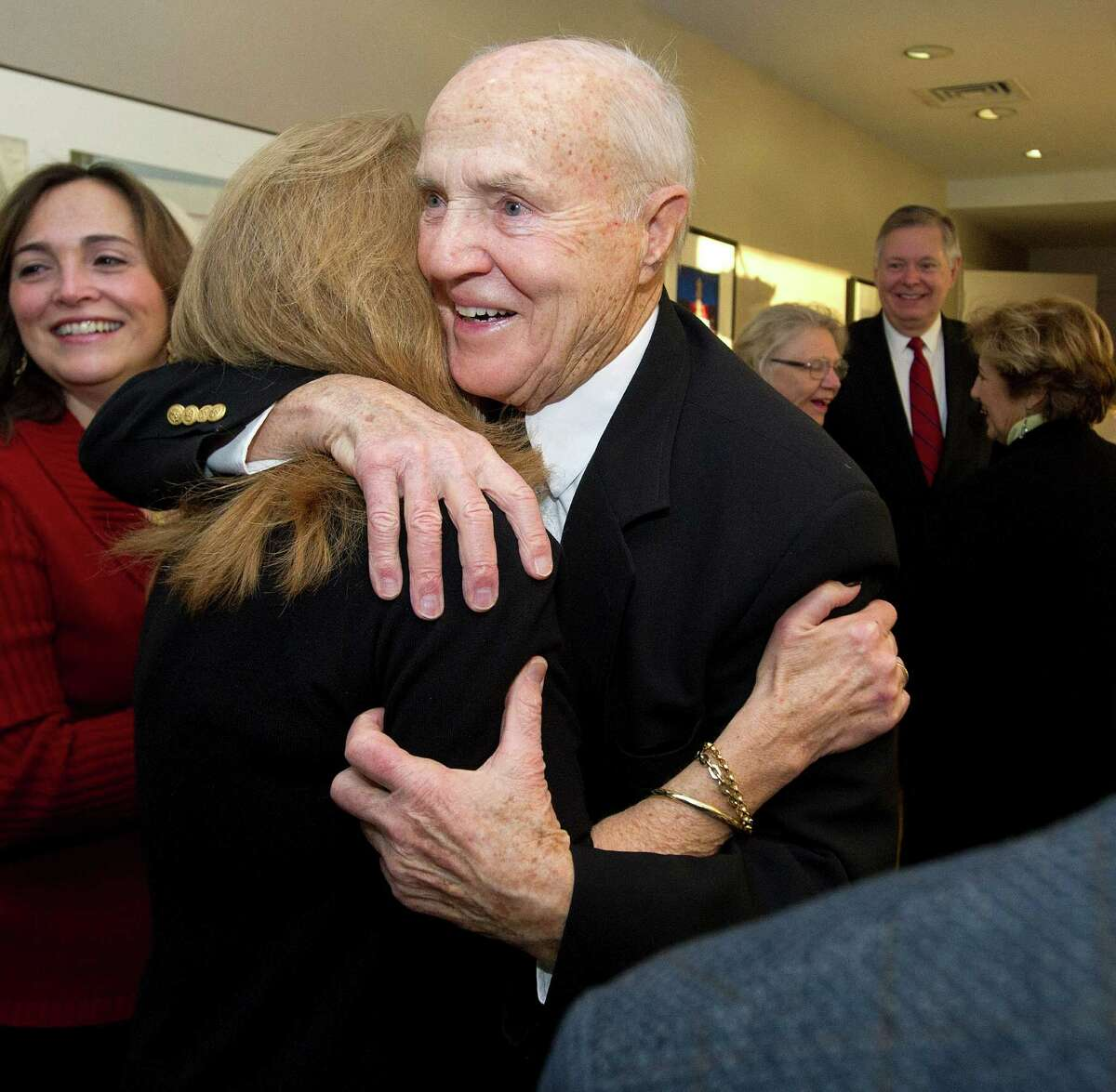 Tim Curtin, special assistant to the mayor, is congratulated by Donna Loglisci, City and Town Clerk, as Curtin is surprised with a ceremony to name him the Citizen of the Year at Government Center in Stamford, Conn., on Thursday, January 9, 2014.