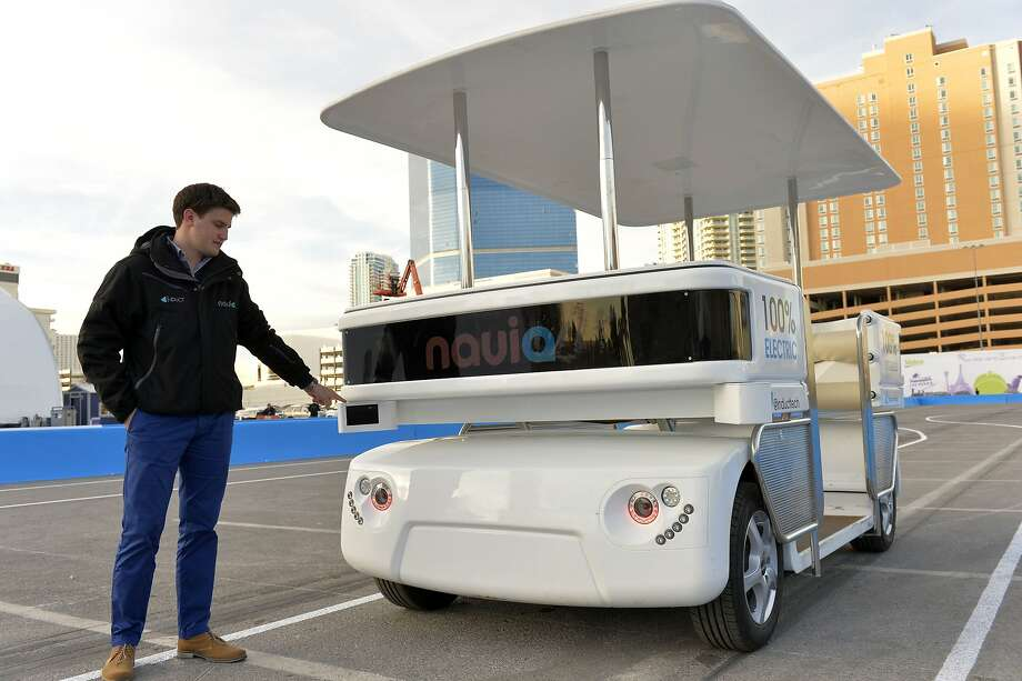 Raphael Gindrat of Induct shows off the self-driving Navia, which resembles a souped-up golf cart, at CES in Las Vegas. Photo: Jack Dempsey, Associated Press