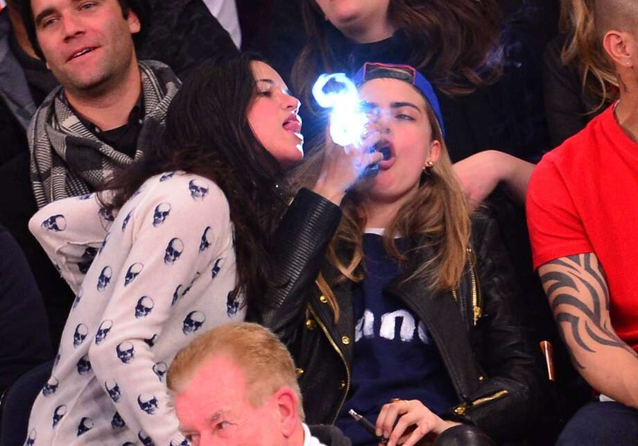 Michelle Rodriguez and Cara Delevingne attend the Detroit Pistons vs New York Knicks game at Madison Square Garden on January 7, 2014 in New York City. Photo: James Devaney, WireImage