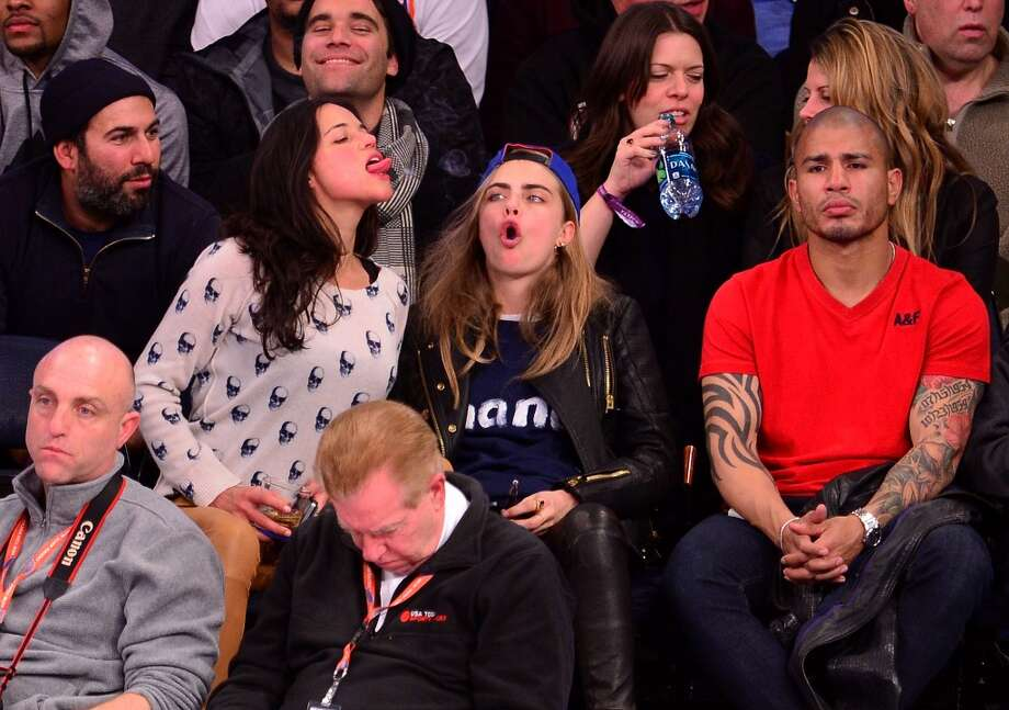 Michelle Rodriguez, Cara Delevingne and Miguel Cotto attend the Detroit Pistons vs New York Knicks game at Madison Square Garden on January 7, 2014 in New York City. Photo: James Devaney, WireImage