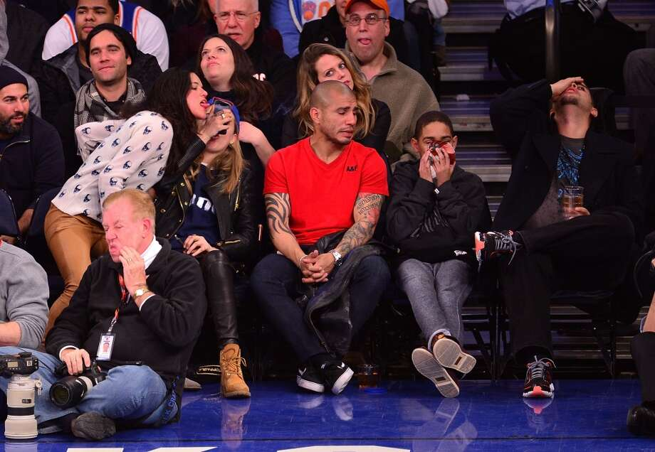 Michelle Rodriguez, Cara Delevingne, Miguel Cotto, Miguel Cotto Jr and guest attend the Detroit Pistons vs New York Knicks game at Madison Square Garden on January 7, 2014 in New York City. Photo: James Devaney, WireImage