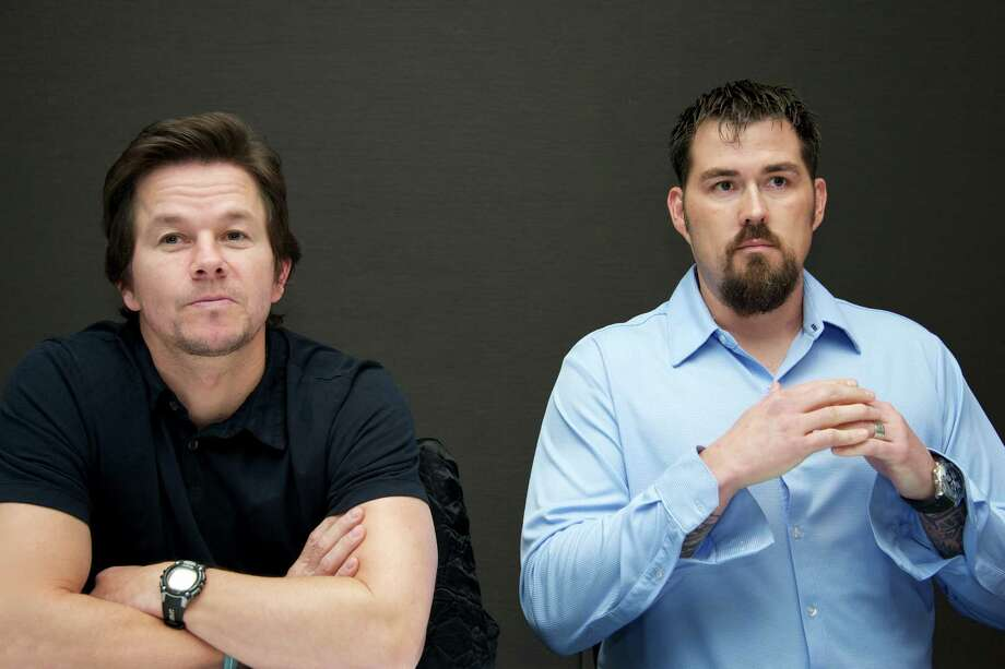 Here are Mark Wahlberg and Houstonian Marcus Luttrell at the 'Lone Survivor' Press Conference on December 6, 2013 in New York City. Photo: Vera Anderson, Contributor / 2013 Vera Anderson