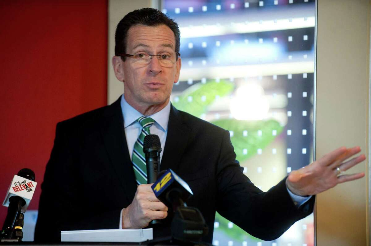 Governor Dannel Malloy speaks during the ribbon cutting ceremony for AmeriCares' Free Clinic of Stamford at the organization's headquarters in Stamford, Conn., on Thursday, January 9, 2014.