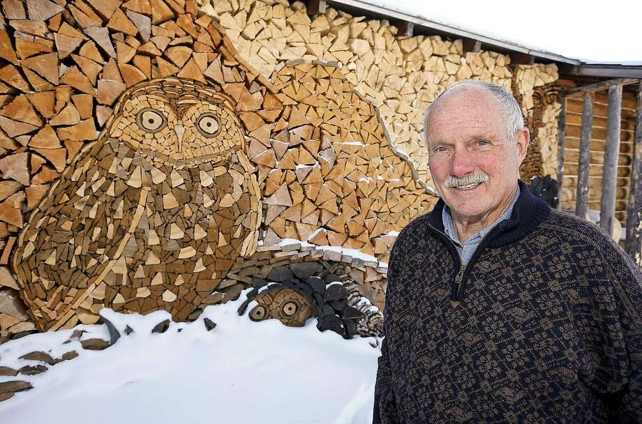 Whooo stacked this wood? Whooo?That would be Gary Tallman of Monarch, Mont., who turned his ample supply of firewood into an owl mosaic. Photo: Larry Beckner, Associated Press