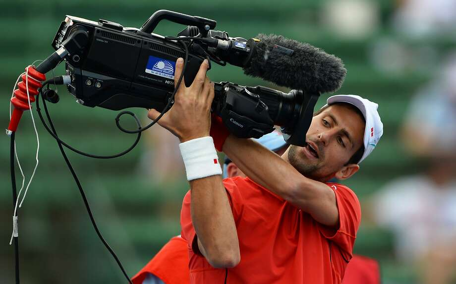 I'm ready for my closeup:  Novak Djokovic takes the selfie to a whole new level before an exhibition match at the invitational Kooyong Classic 