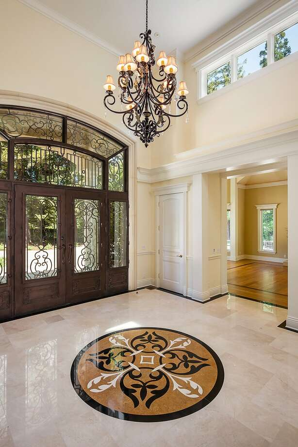 The two-story foyer includes extensive millwork, marble floor with custom inlay and a domed ceiling. Photo: David Eichler/Eichlerphoto.com, Photo By David Eichler