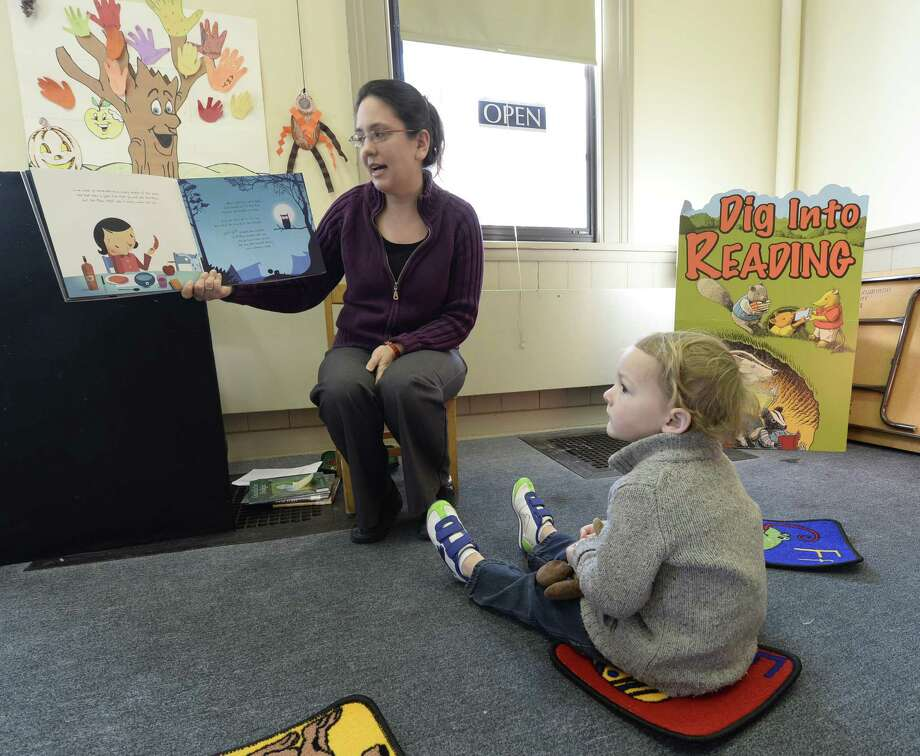 Librarian Patti Lloyd reads for four-year-old Bert Trzebacz during a Storytime session Thursday morning, Jan. 9, 2014, at the Lansingburgh Branch of the Troy Public Library in Troy, N.Y.   (Skip Dickstein / Times Union) Photo: Skip Dickstein / 00025295A