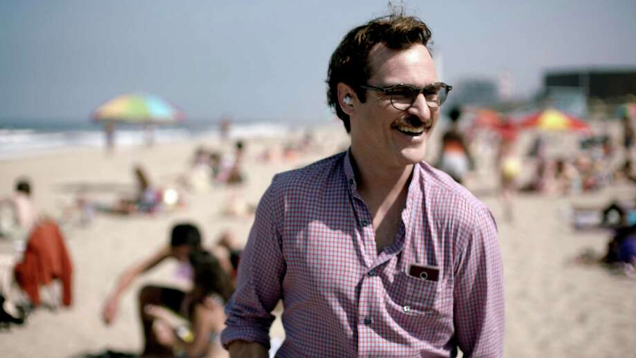 "FILE - This file image provided by Warner Bros. Pictures shows Joaquin Phoenix in a scene from ""Her."" In ""Her,"" Spike Jonze's futuristic exploration of a man's relationship with his computer, the filmmaker surveys human disjunction. (AP Photo/Warner Bros. Pictures, File) ORG XMIT: NYSB401 / Warner Bros. Pictures"