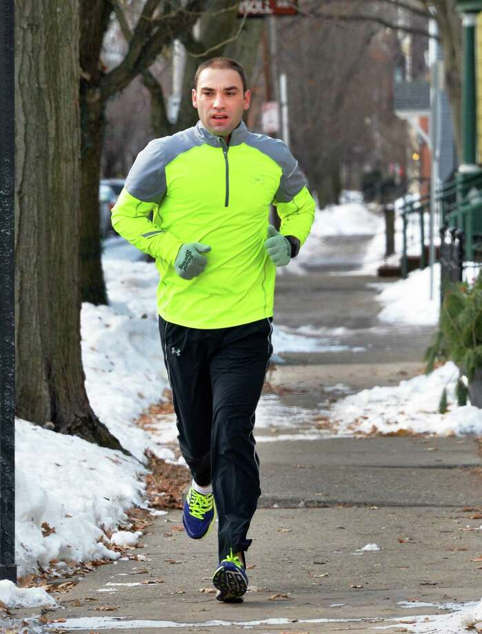 Paul Datka of Ballston Spa takes advantage of Thursday's milder temperatures for a lunch hour run through the Stockade neighborhood Thursday Jan. 9, 2014, in Schenectady, N.Y.  (John Carl D'Annibale / Times Union) Photo: John Carl D'Annibale / 00025301A