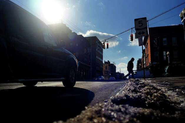 The sun shines down on Lark St. but the wind still made it cold for those walking out on the streets on Thursday, Jan. 9, 2014 in Albany, NY.  (Paul Buckowski / Times Union) Photo: Paul Buckowski / 00025301A