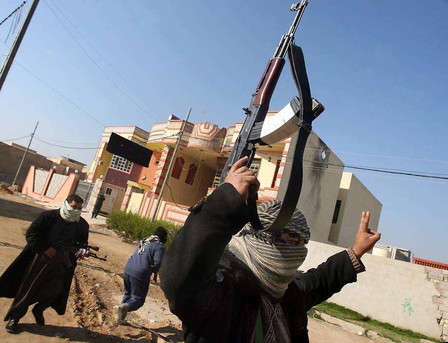 Gunmen patrol Fallujah. Some tribal leaders have warned al Qaeda to leave or face a showdown. Photo: Str, Associated Press
