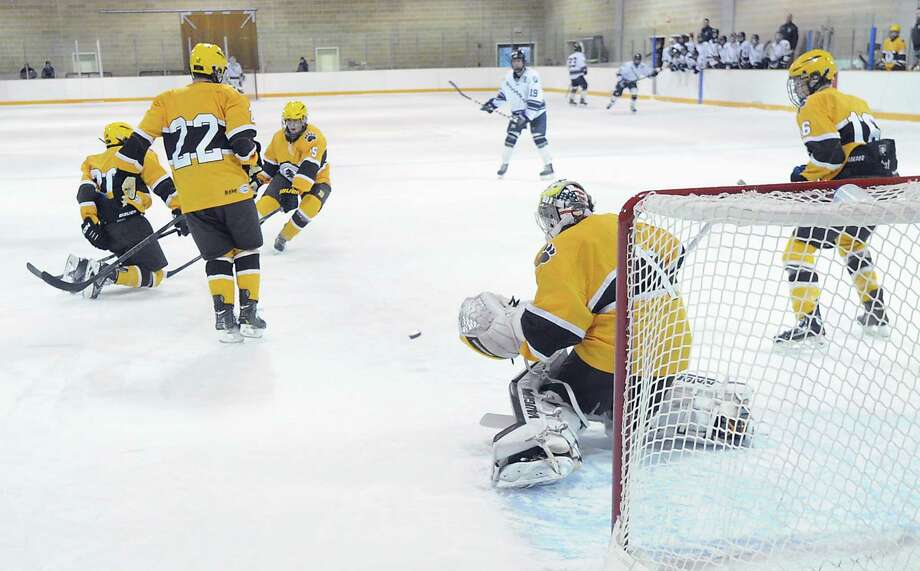 Brunswick goalie Alex Connal makes a stop during the boys high school ice hockey game between Brunswick School and Millbrook School at Brunswick in Greenwich, Wednesday afternoon, Jan. 8, 2014. Photo: Bob Luckey / Greenwich Time