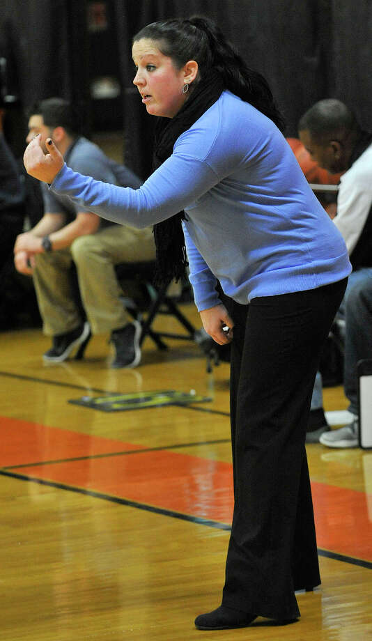 Stamford girls basketball head coach Diane Burns talks to her team during their game against St. Joseph at Stamford High School in Stamford, Conn., on Tuesday, Jan. 7, 2014. Stamford won, 59-40. Photo: Jason Rearick / Stamford Advocate