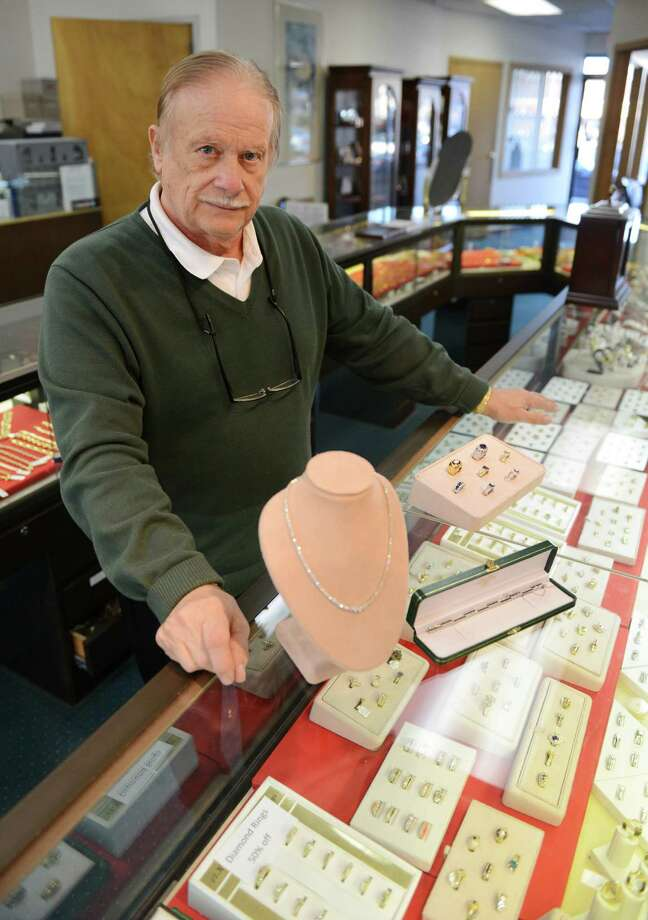 Frank Cappiello, owner of Cappiello Jewelers, poses behind the counter inside his store in Danbury, Conn. on Thursday, Jan. 9, 2014.  Cappiello Jewelers is celebrating its 50th anniversary this year. Photo: Tyler Sizemore / The News-Times