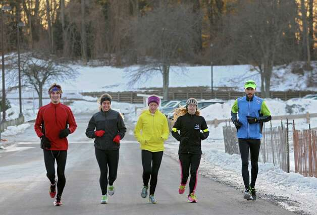 A group of runners heads through the University at Albany campus after jogging down Western Ave. Thursday afternoon, Jan. 9, 2014, in Albany, N.Y.  (Lori Van Buren / Times Union) Photo: Lori Van Buren / 00025301A
