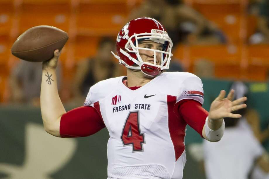 Derek Carr  Fresno State  Redshirt senior  6-3, 218 pounds  Career stats: 12,843 yards, 113 TD, 24 INT, 66.7 completion percentage  The younger brother of former No. 1 overall pick David Carr threw for 5,082 yards and 50 touchdowns  during his senior season at Fresno State. Photo: Eugene Tanner, Associated Press