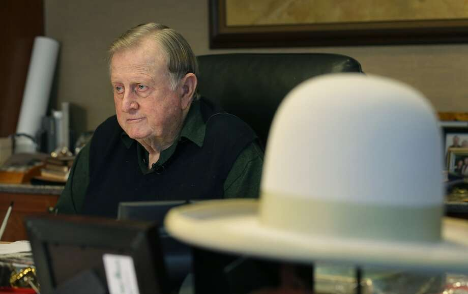 A ten gallon hat sets on the desk of Red McCombs as he talks about his recent comments on the new Longhorn Football Coach Charlie Strong. Thursday, Jan. 9, 2013. Photo: BOB OWEN, San Antonio Express-News