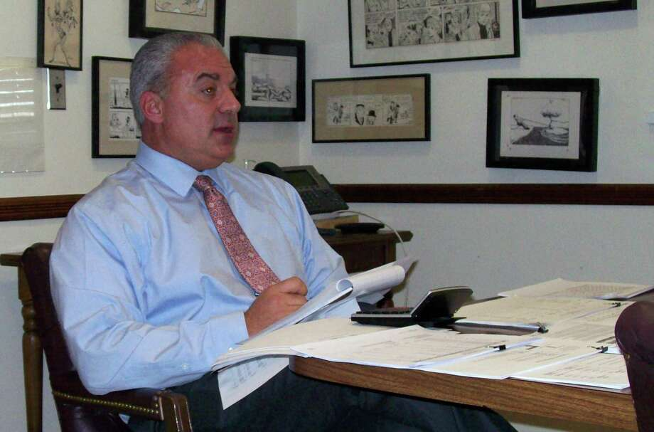 Elio Longo, the school district's business manager, explains the shortfall in the Board of Education's current budget during a meeting of an ad hoc committee looking into the matter. Photo: Anne M. Amato / Westport News
