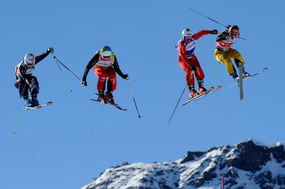 A photo taken on Dec. 15, 2013 shows Norway's Marie Hoeie Gjefsen, Keisey Serwa, Katrin Mueller and France's Marie Berger Sabbatel competing during the FIS World Cup Women's Ski Cross event at the Val Thorens ski resort, French Alps. Some 26 years after freestyle skiiing has been shown as a demonstration sport at the 1988 Winter Olympic Games in Calgary, the halfpipe and ski slopestyle disciplines will make their Olympic debut at the 2014 Winter Olympics in Sochi. Photo: JEAN-PIERRE CLATOT, AFP/Getty Images