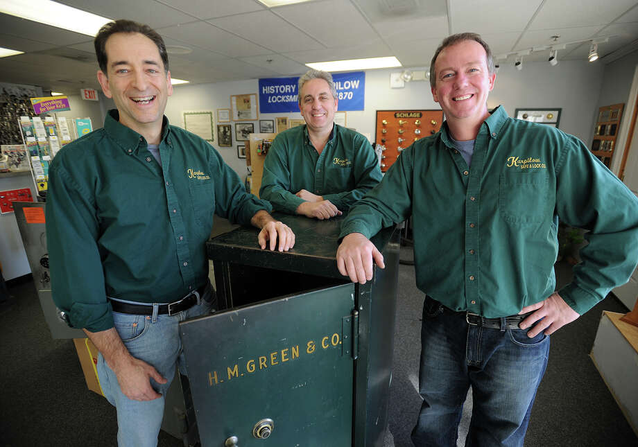 From left; Jeff Silver, Rick Bayuk, and Steve VanWilliams at Karpilow Safe & Lock Co. at 4490 Main Street in Bridgeport, Conn. on Thursday, January 9, 2013. The company has been a family run business in Bridgeport since 1870. Photo: Brian A. Pounds / Connecticut Post