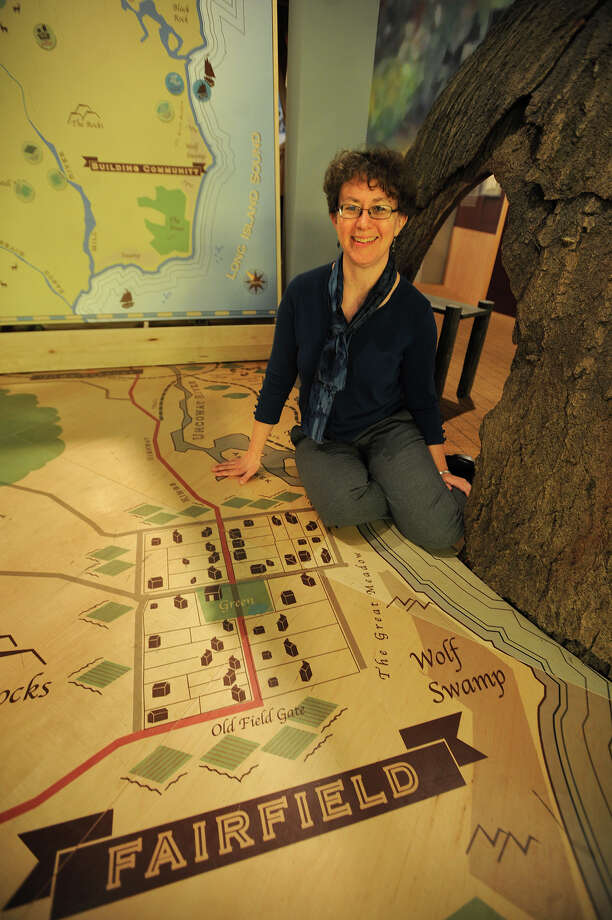 Curator Elizabeth Rose sits on a room sized map of early Fairfield in an exhibit celebrating the town's 375th anniversary at the Fairfield Museum  & History Center in Fairfield, Conn. on Thursday, January 9, 2014. Photo: Brian A. Pounds / Connecticut Post