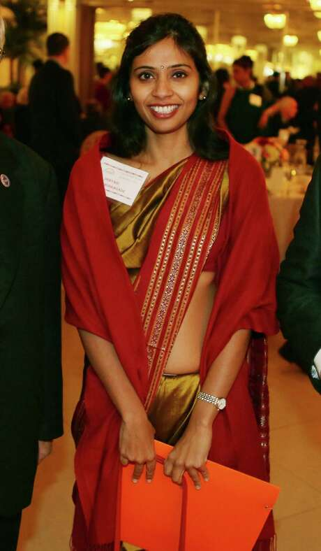 FILE - This Dec. 8, 2013 file photo shows Devyani Khobragade, India's deputy consul general, during a Stony Brook University fundraiser on Long Island in Stony Brook, N.Y. Khobragade, 39, was arrested in New York and charged with lying on a visa form by stating she paid her housekeeper $4,500 a month when she actually was paying her under $3 per hour, less than half the minimum wage. The prosecution of Khobragade highlights a problem advocates say is all too common — workers for foreign governments who bring along the baggage of human trafficking to the U.S. Khobragade's attorney Daniel Arshack has said that his client is innocent and that investigators made a critical error by misreading her visa applications, which were not fraudulent. The case has prompted outrage and protests in India, where officials there say she is the innocent victim of a scheming worker. (AP Photo/Mohammed Jaffer, File) Photo: Mohammed Jaffer, STR / SnapsIndia