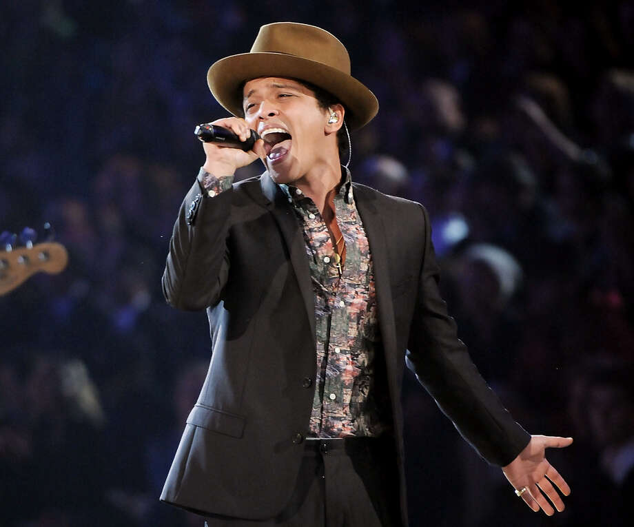 "Bruno Mars says he's ready to perform at the Super Bowl halftime show — chilly weather and all — ""... even if I have to build a chimney onstage, perform around a fire, I'll do it."" Photo: Associated Press File Photo / Invision"
